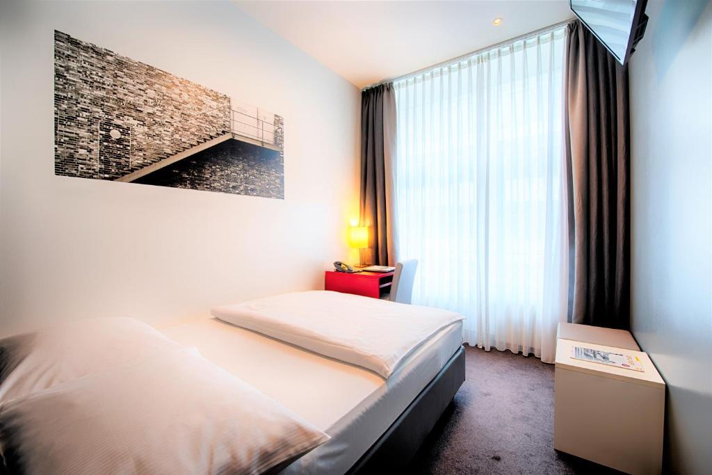 Habitación Individual Select Hotel Berlin Gendarmenmarkt 4* Medio Maratón Berlín Travelmarathon.es